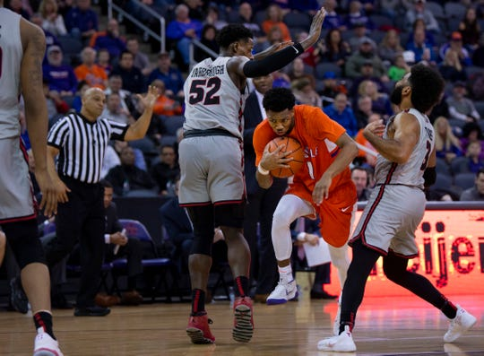 Evansville's Marty Hill (1) splits Illinois State defenders Milik Yarbrough (52) and Keyshawn Evans (3) at the Ford Center Saturday afternoon, Jan. 19, 2019.