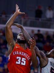 Evansville's John Hall (35) is fouled by Illinois State's Milik Yarbrough at the Ford Center Saturday afternoon, Jan. 19, 2019.