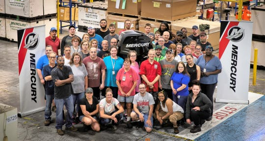 Mercury Marine assembly workers from Plant 15's third shift stand with the final inline four-cylinder Verado engine to come off the line. Mercury's new V-6 Verado engines replaced the retired inline four-cylinder models in 2018 when Mercury Marine launched its largest single product development program in its history.