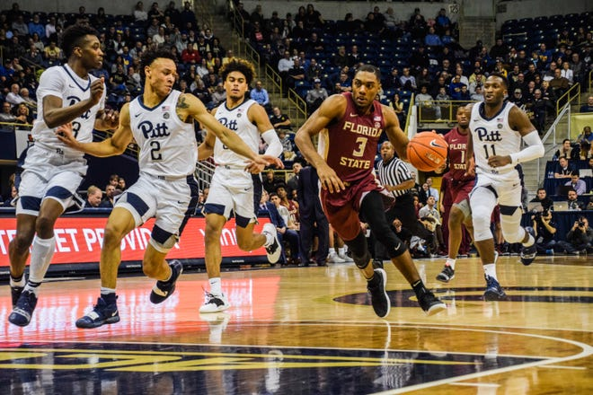 Trent Forrest drives in to the basket against Pitt.
