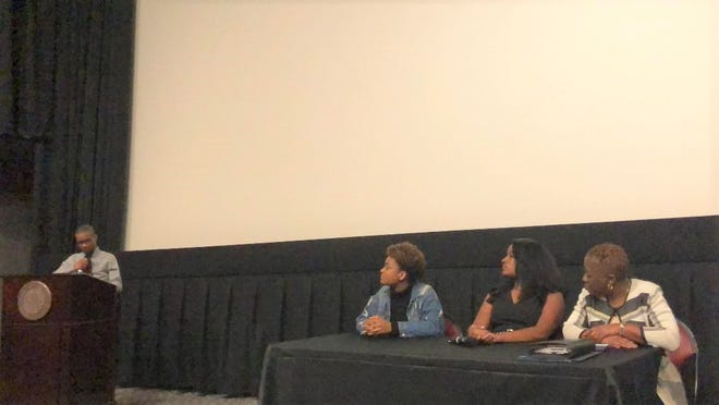 Dwight James III, the host of the panel and one of the people who helped coordinate the events for the 31st Annual Martin Luther King Jr. week at FSU, questions the panel. (Pictured left to right: Nastassia Janvier, Jasmine Ali, and Cassandra Jenkins)