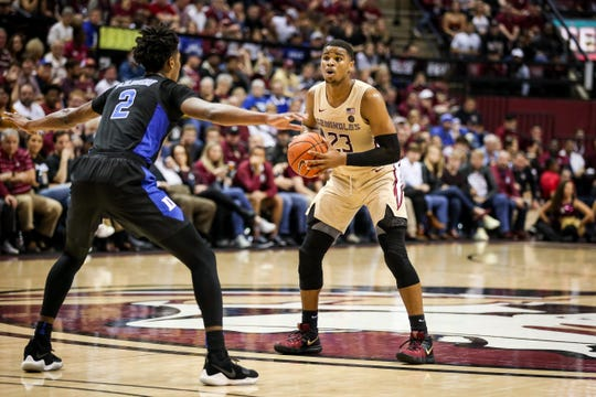 M.J. Walker (23) controlled FSU's offensive moves in the second half, dishing out 5 assists against Duke on Saturday, January 12th.