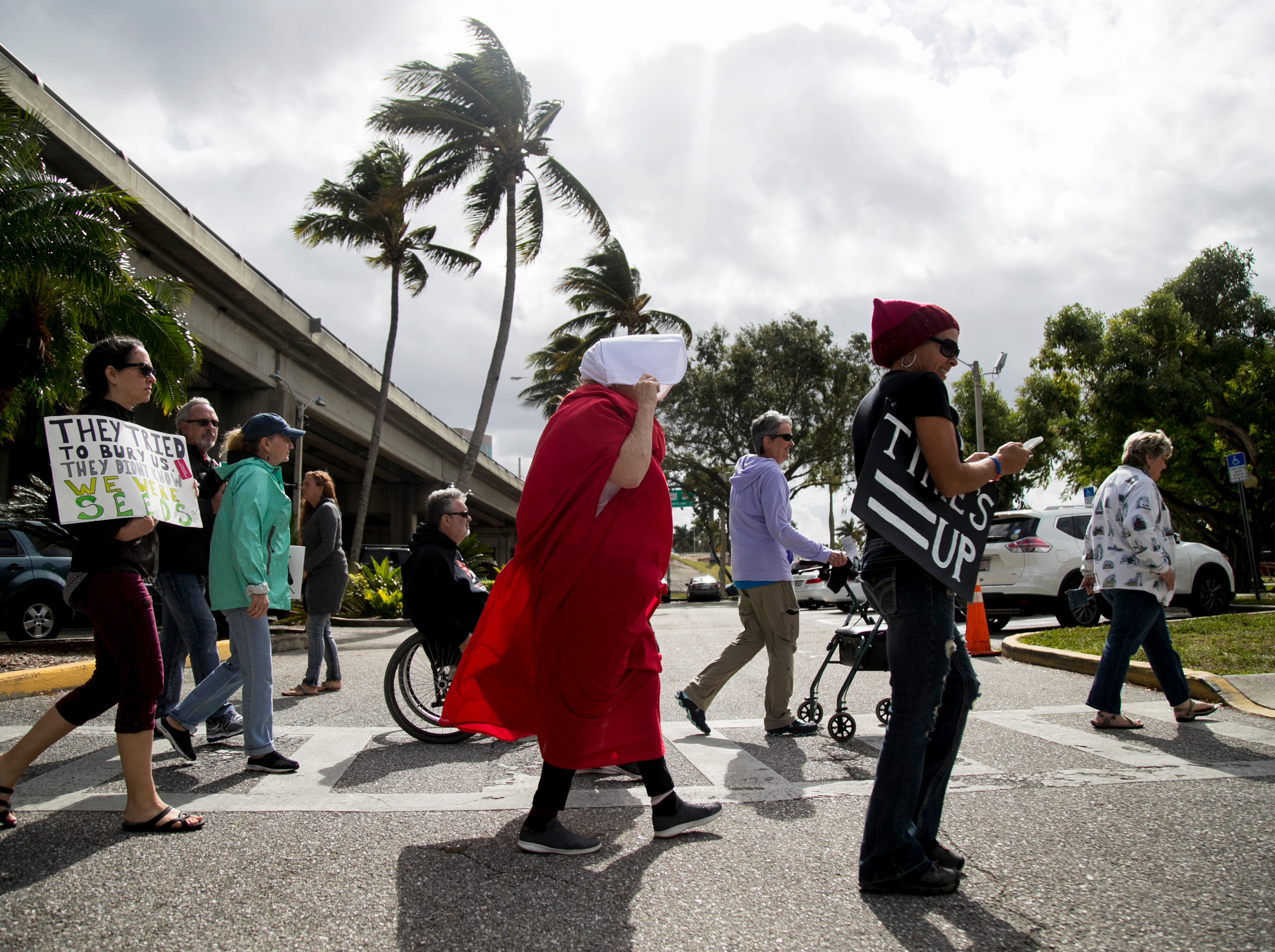 Participants in the Fort Myers Women's March return to Centennial Park after marching through downtown Fort Myers on Sunday, Jan. 20, 2019.
