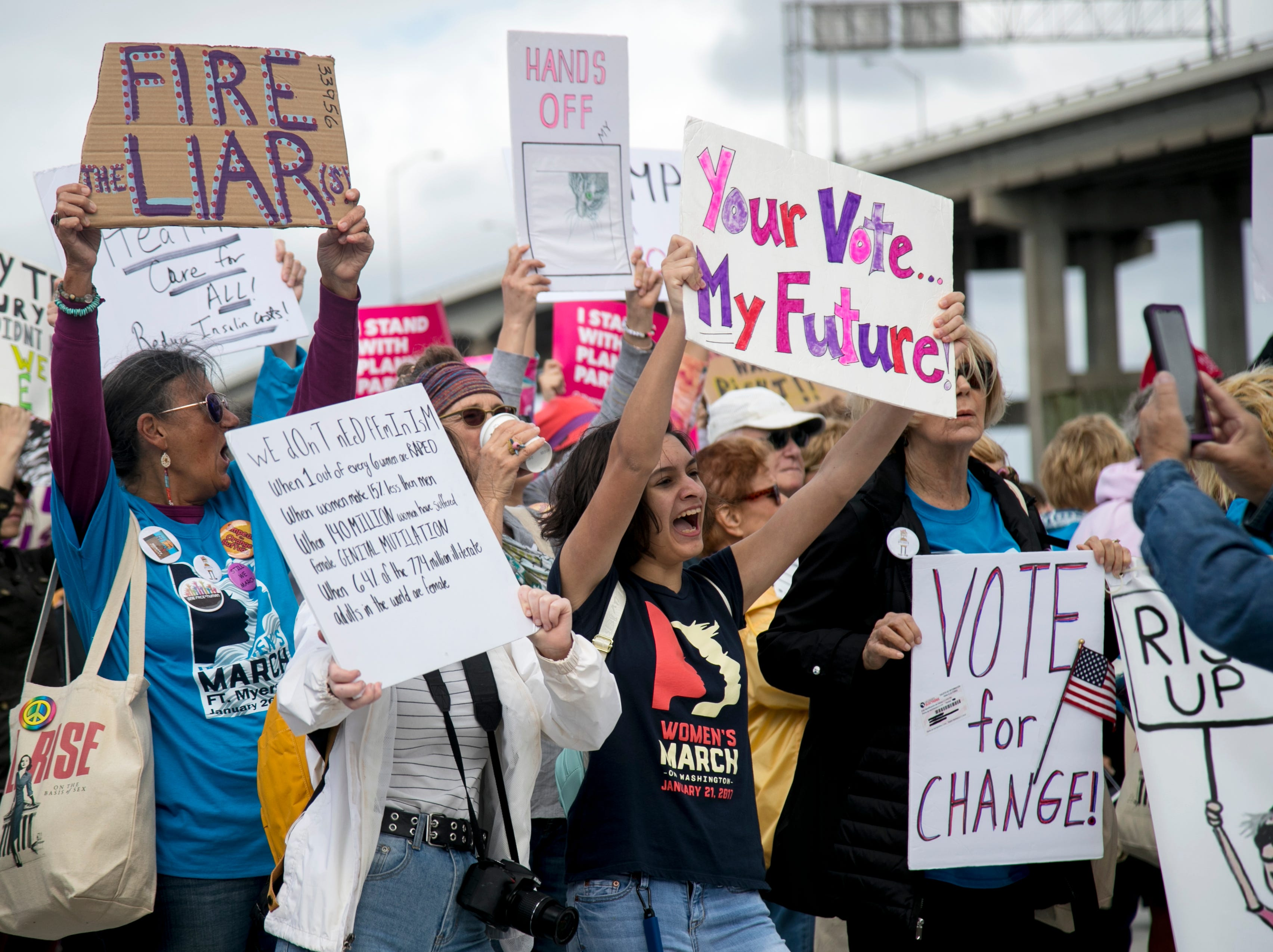 Participants in the Fort Myers Women's March cheer after marching through downtown Fort Myers on Sunday, Jan. 20, 2019.