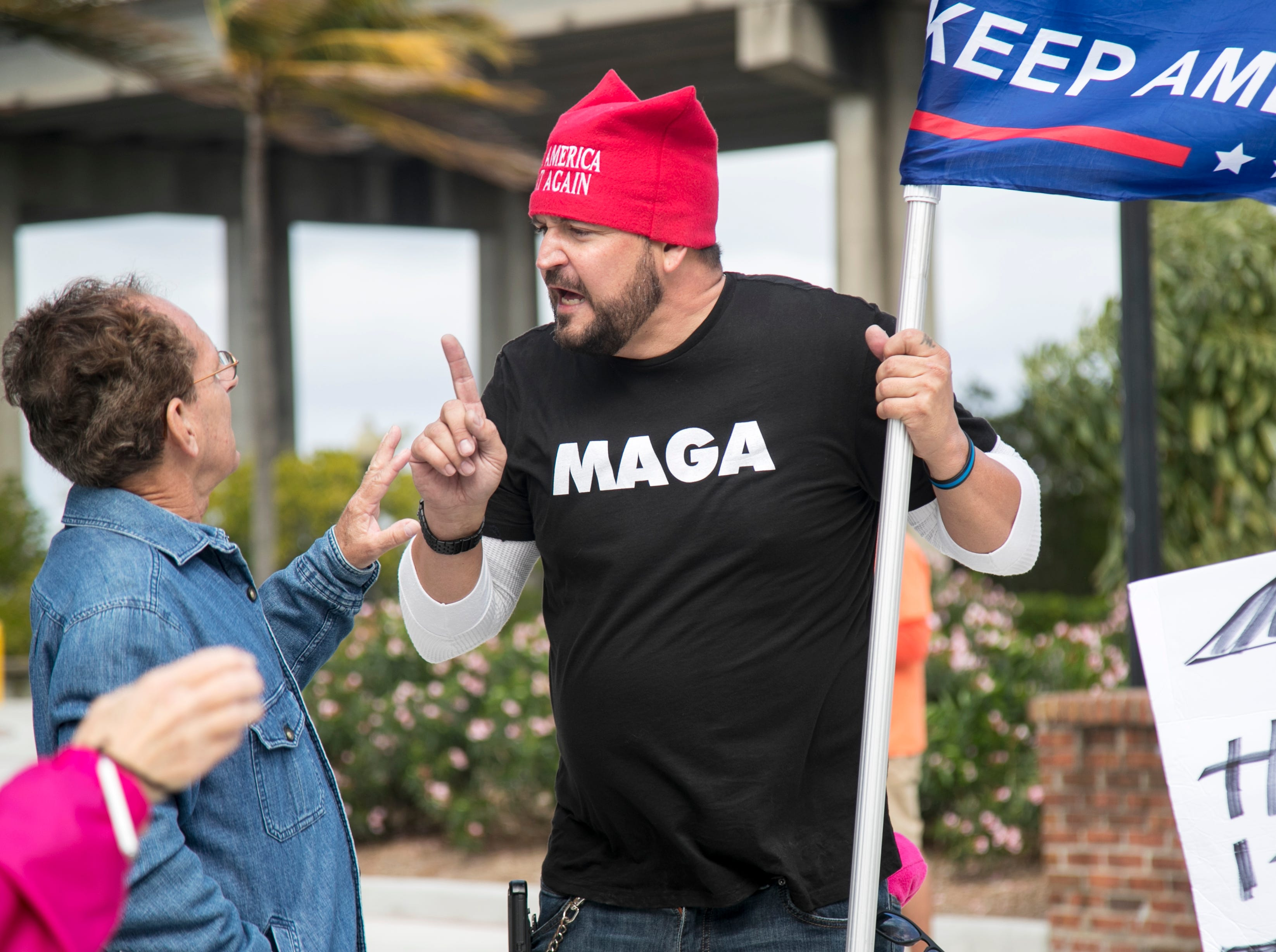 Gary Snow, right, confronts a man participating in the Fort Myers Women's March on Sunday, Jan. 20, 2019, at Centennial Park.