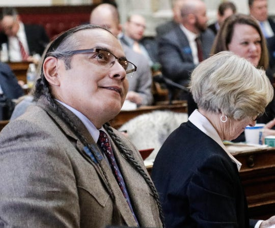Freshman Rep. Marvin Weatherwax Jr., D-Browning, looks up at the results of a roll call vote on Rep. Rae Peppers' bill to streamline missing persons reports, which passed its first vote 100-0 on Jan. 18.