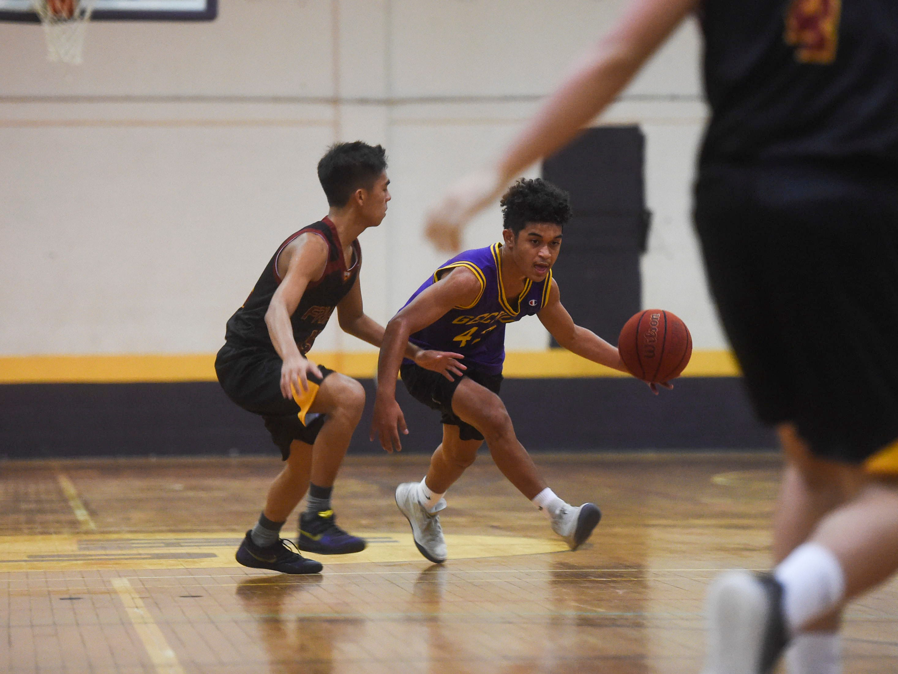 George Washington's Josh Sebastian brings the ball downcourt against the Father Duenas Friars during their Independent Interscholastic Athletic Association of Guam Boys' Basketball game at the GW High School gym, Jan. 19, 2019. The Friars came through with a 52-69 comeback victory over the Geckos after trailing in the first half.