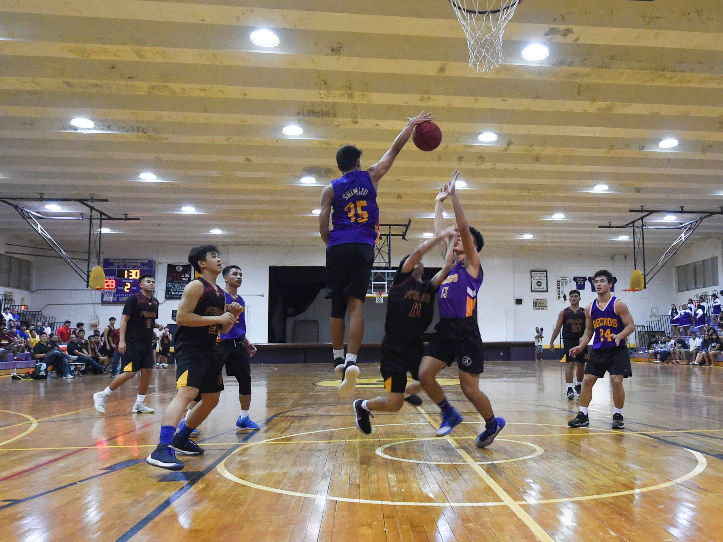 George Washington's Ron Shimizu (35) rises for a block attempt against the Friars during their Independent Interscholastic Athletic Association of Guam Boys' Basketball game at the GW High School gym, Jan. 19, 2019. The Friars came through with a 52-69 comeback victory over the Geckos after trailing in the first half.