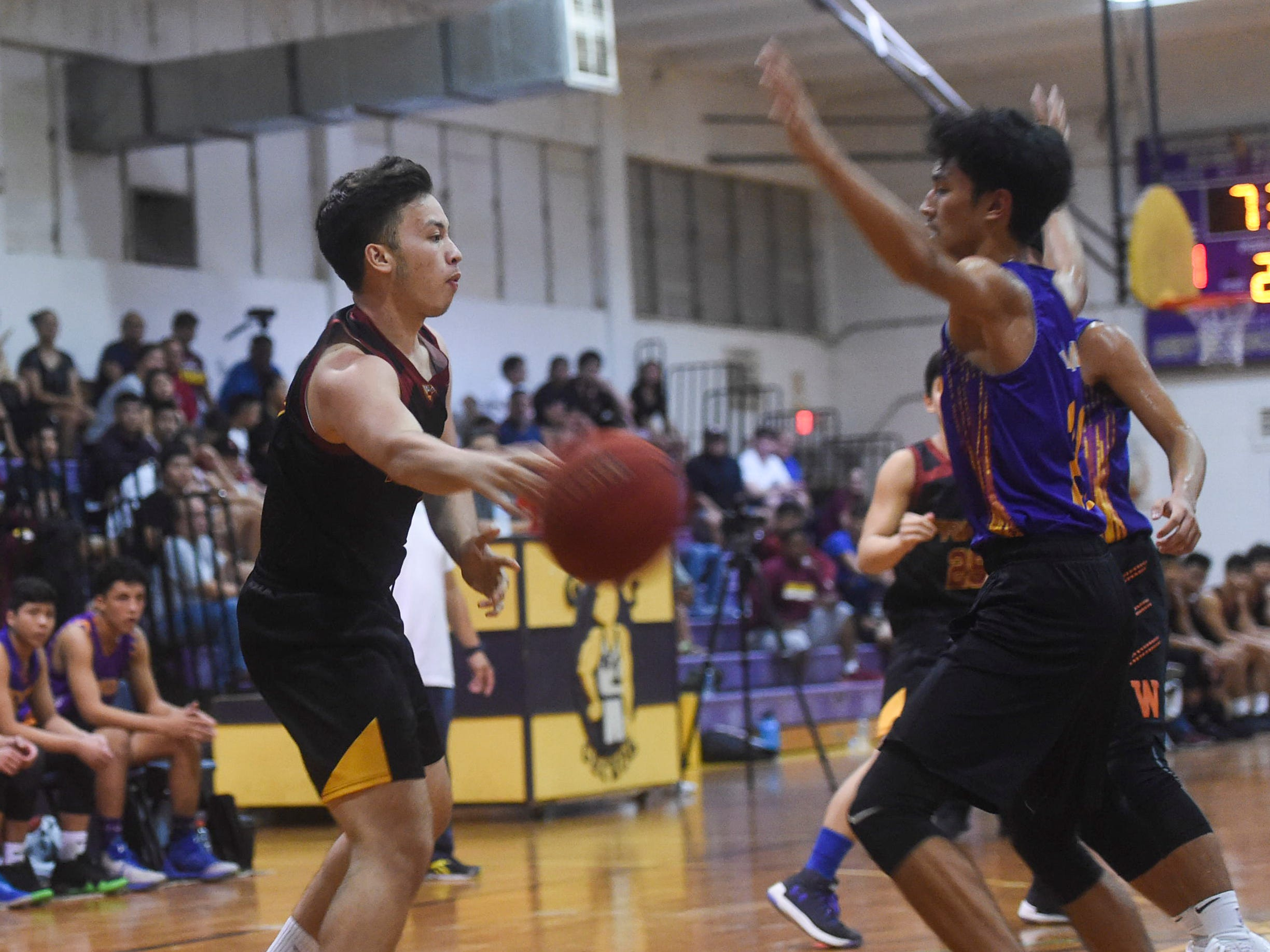 Father Duenas' Raymond Castro passes the ball to the post against the George Washington Geckos during their Independent Interscholastic Athletic Association of Guam Boys' Basketball game at the GW High School gym, Jan. 19, 2019. The Friars came through with a 52-69 comeback victory over the Geckos after trailing in the first half.