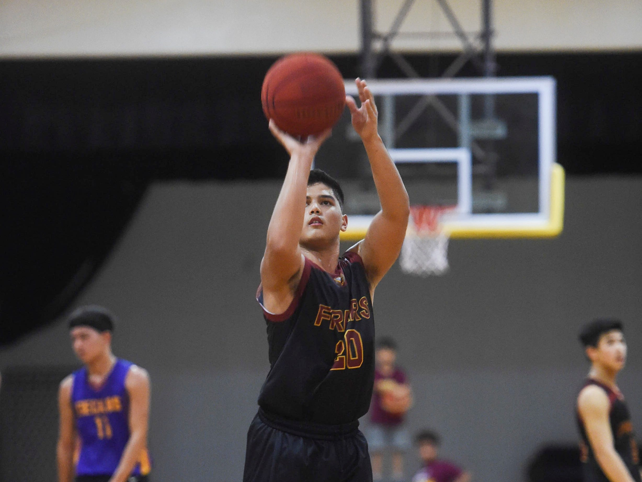 Father Duenas player Christian Taitano (20) shoots a free throw during an Independent Interscholastic Athletic Association of Guam Boys' Basketball game the home team George Washington Geckos at the GW High School gym, Jan. 19, 2019. The Friars came through with a 52-69 comeback victory over the Geckos after trailing in the first half.