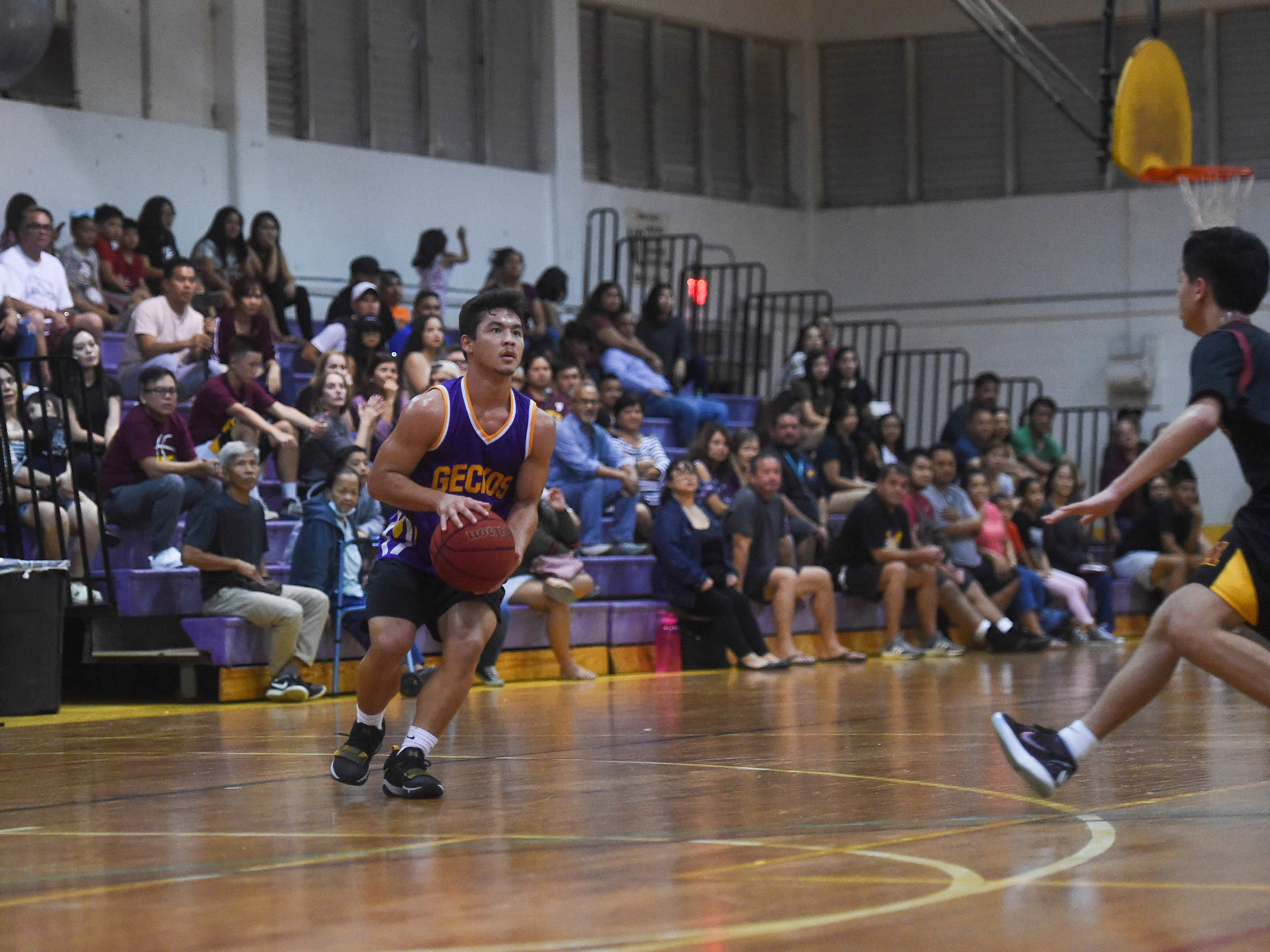 Geckos' Shelby Meeks is left alone at the 3-point line during an Independent Interscholastic Athletic Association of Guam Boys' Basketball game against the Friars at the George Washington High School gym, Jan. 19, 2019. The Friars came through with a 52-69 comeback victory over the Geckos after trailing in the first half.