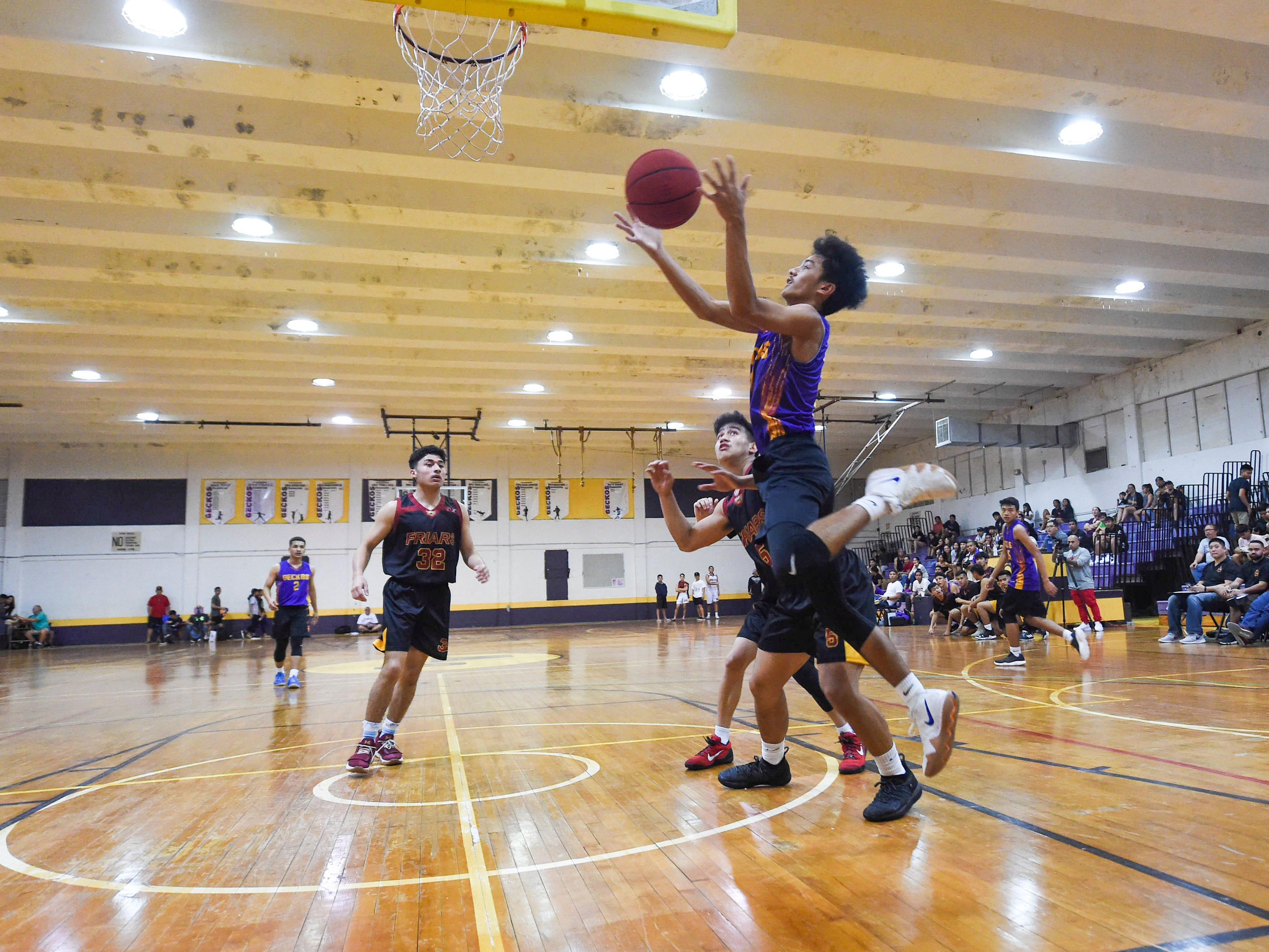George Washington player William Palomo grabs a rebound against the Friars during their Independent Interscholastic Athletic Association of Guam Boys' Basketball game at the GW High School gym, Jan. 19, 2019. The Friars came through with a 52-69 comeback victory over the Geckos after trailing in the first half.