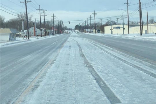 South Green Street is a sheet of ice Sunday morning, according to Henderson emergency officials.