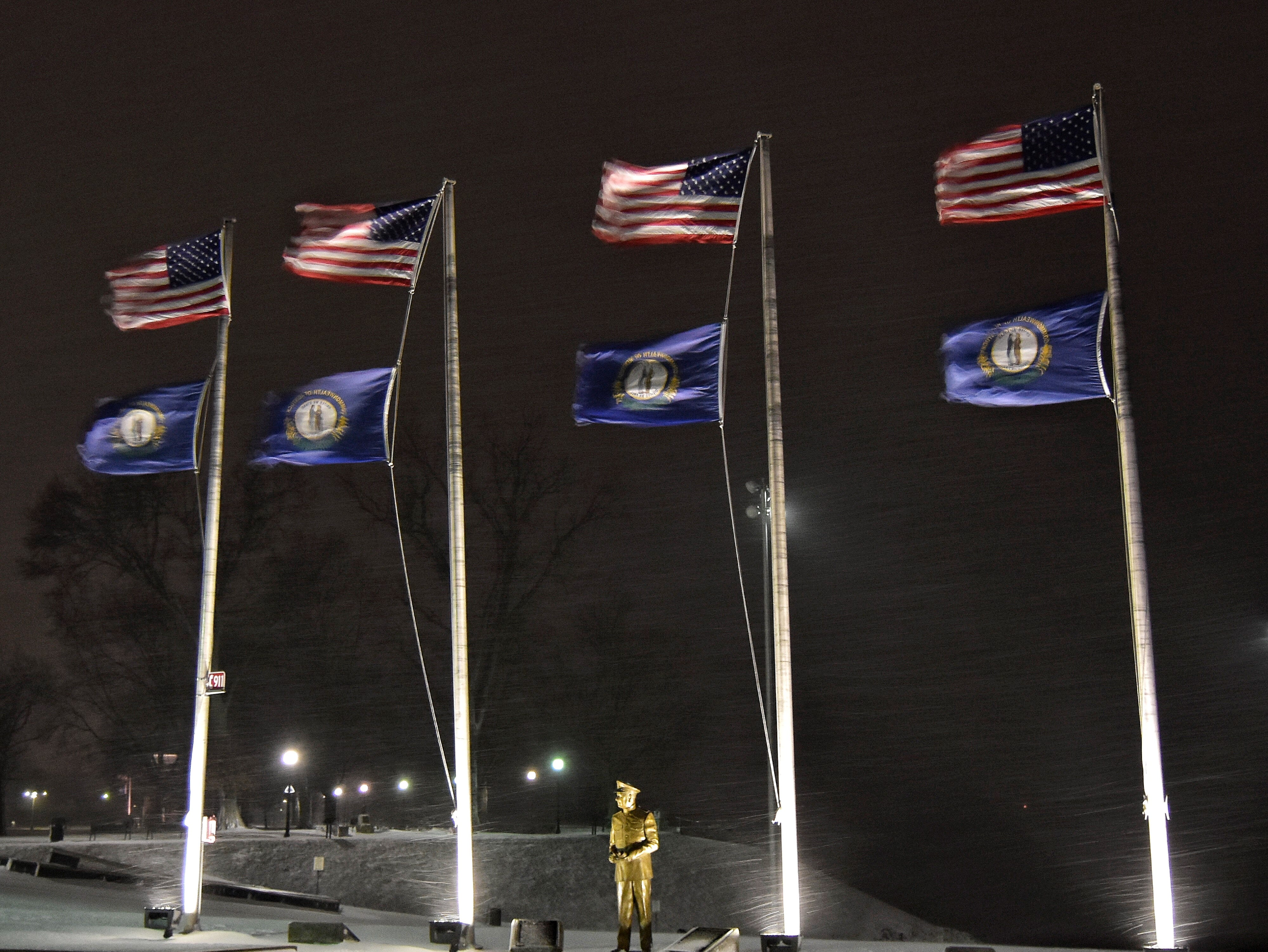 The statue of Admiral Husband E. Kimmel keeps watch even in the freezing wind Saturday night.