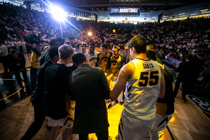 Iowa Hawkeyes huddle up following introductions during a NCAA Big Ten Conference men's basketball game on Sunday, Jan. 20, 2019, at Carver-Hawkeye Arena in Iowa City, Iowa.