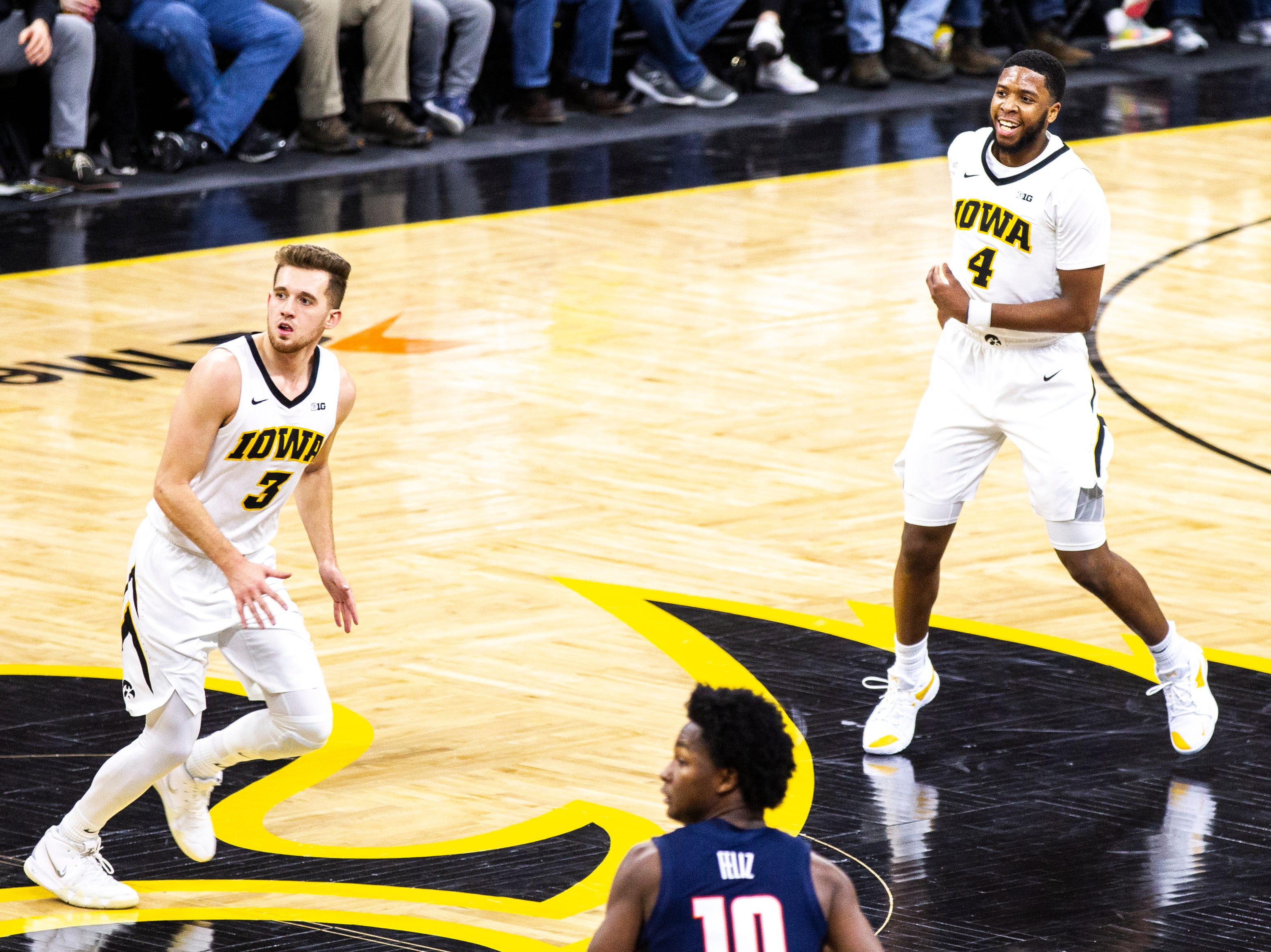 Iowa guard Isaiah Moss (4) smiles while settling in on defense after making a 3-point basket during a NCAA Big Ten Conference men's basketball game on Sunday, Jan. 20, 2019, at Carver-Hawkeye Arena in Iowa City, Iowa.