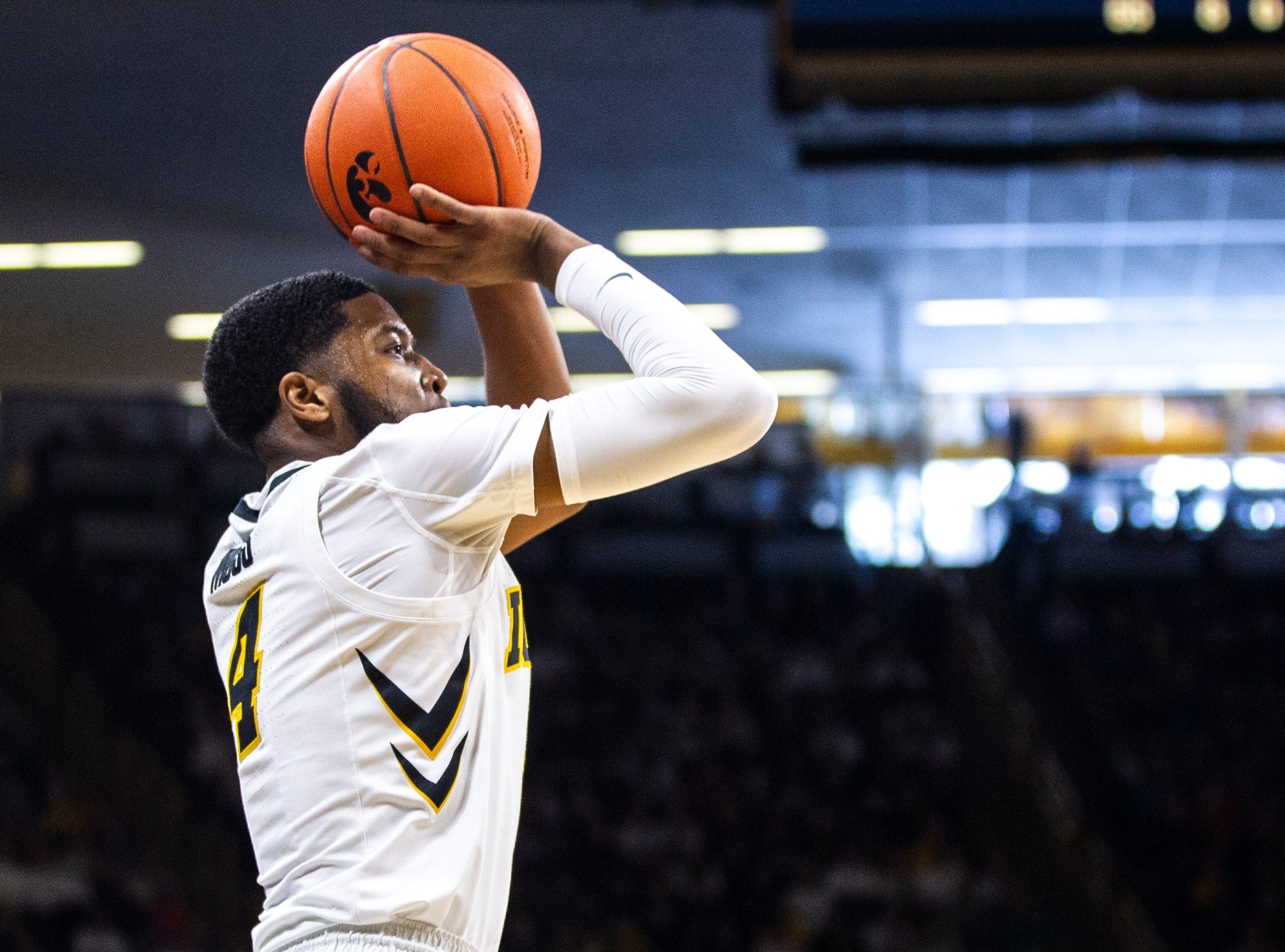 Iowa guard Isaiah Moss (4) makes a 3-point basket at the end of the first half during a NCAA Big Ten Conference men's basketball game on Sunday, Jan. 20, 2019, at Carver-Hawkeye Arena in Iowa City, Iowa.