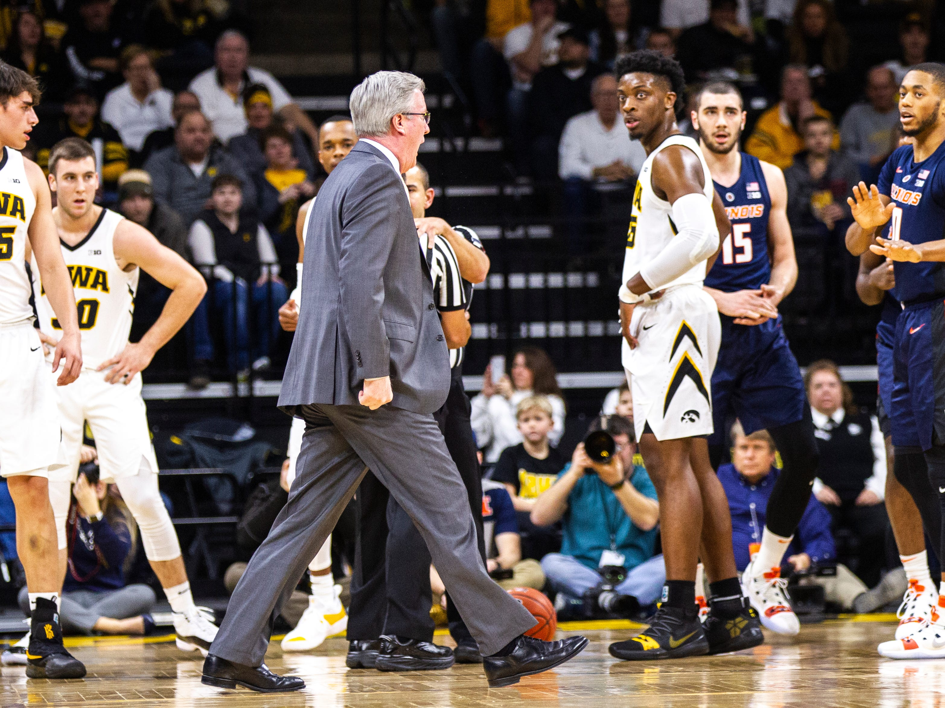 Iowa men's basketball head coach Fran McCaffery yells while walking out on the court following a jump ball during a NCAA Big Ten Conference men's basketball game on Sunday, Jan. 20, 2019, at Carver-Hawkeye Arena in Iowa City, Iowa.