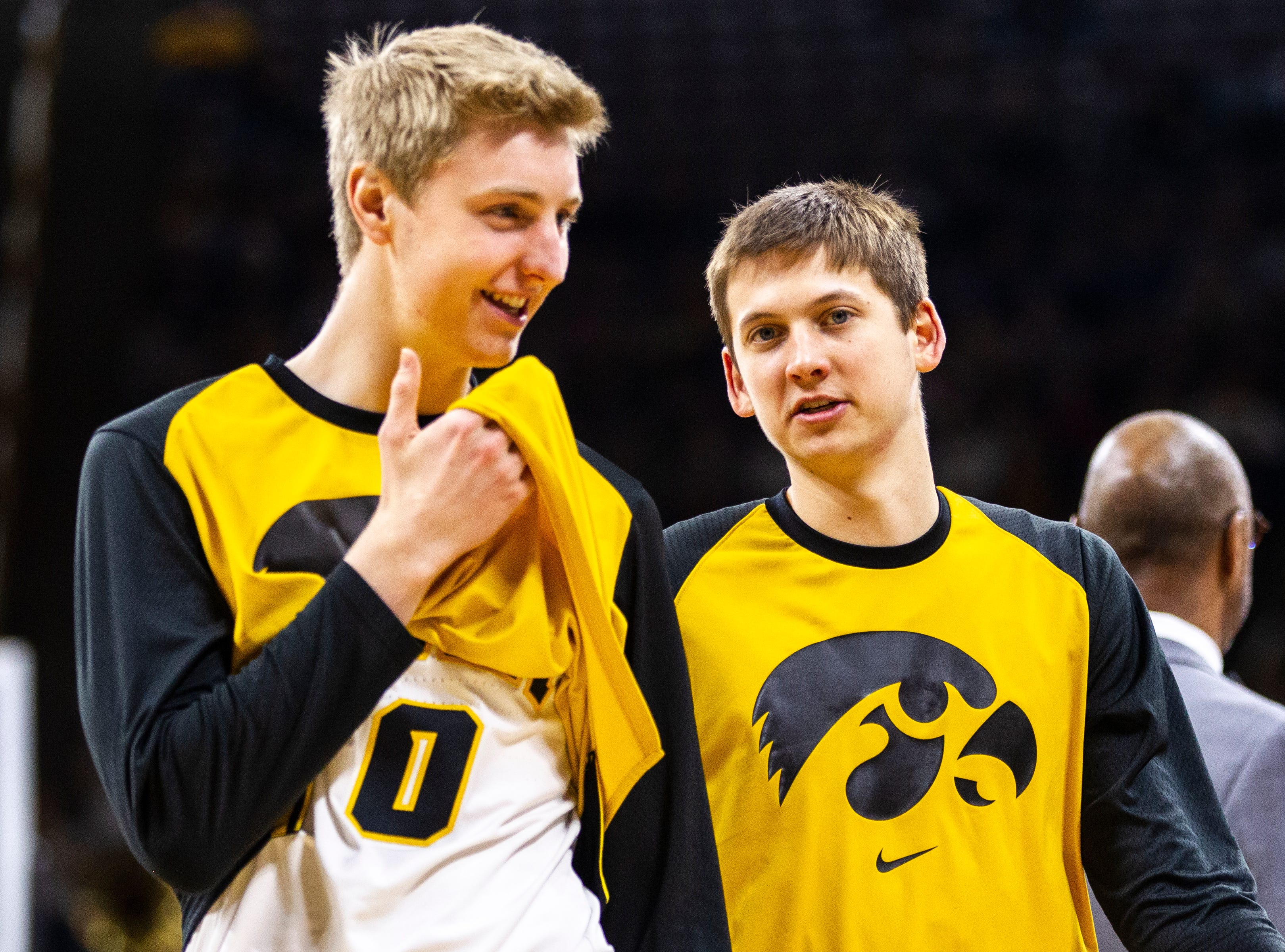 Iowa forward Michael Baer (0) talks with Iowa guard Austin Ash (right) during a NCAA Big Ten Conference men's basketball game on Sunday, Jan. 20, 2019, at Carver-Hawkeye Arena in Iowa City, Iowa.