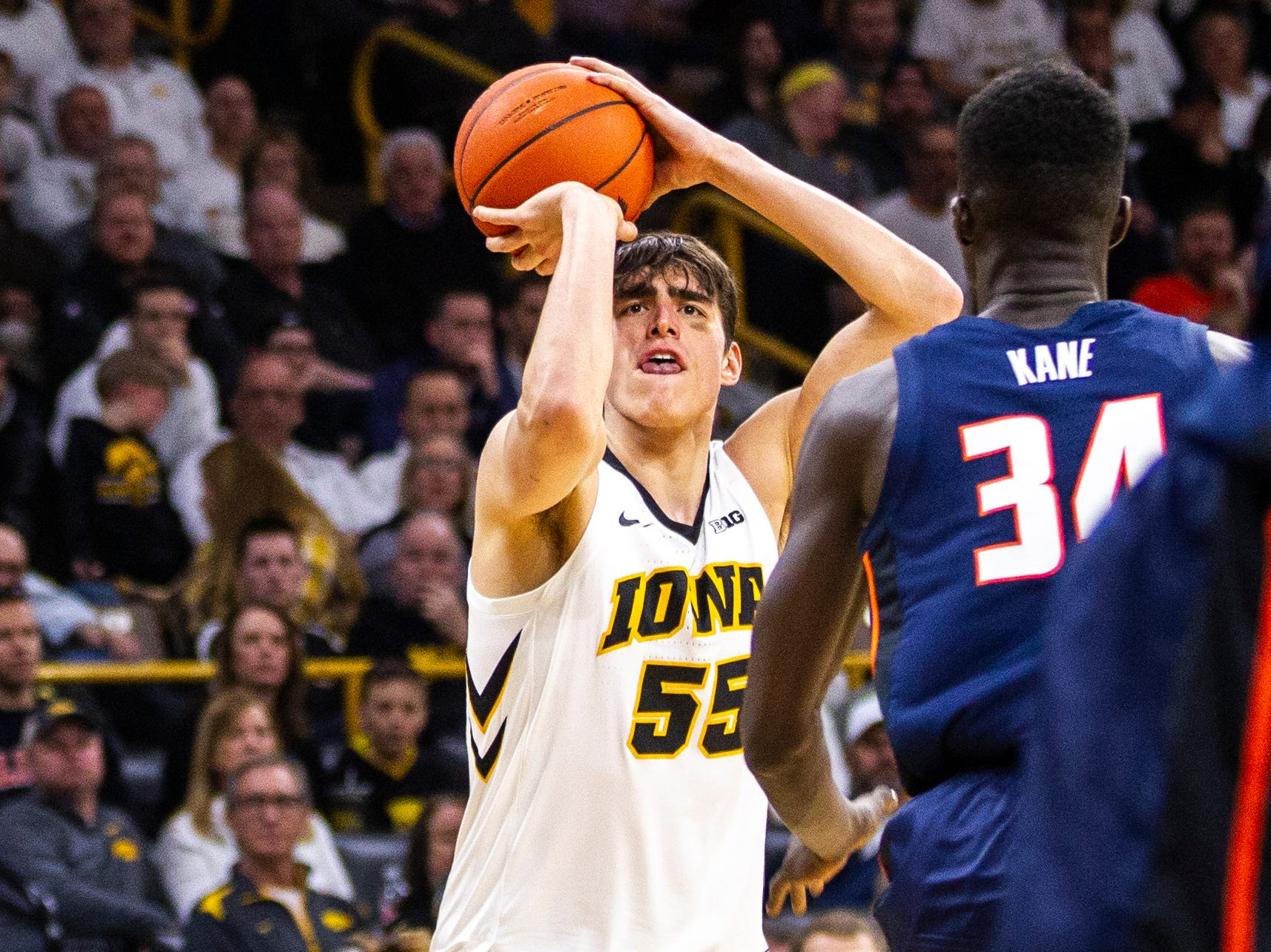Iowa forward Luka Garza (55) shoots a 3-point basket during a NCAA Big Ten Conference men's basketball game on Sunday, Jan. 20, 2019, at Carver-Hawkeye Arena in Iowa City, Iowa.