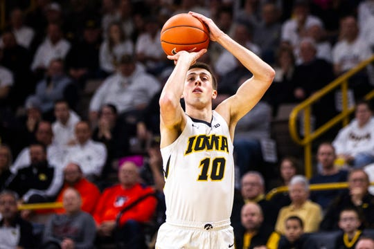 Iowa guard Joe Wieskamp (10) shoots a 3-point basket during a NCAA Big Ten Conference men's basketball game on Sunday, Jan. 20, 2019, at Carver-Hawkeye Arena in Iowa City, Iowa.