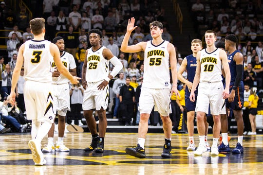 Iowa's players are happy but unsatisfied after a 95-71 win against Illinois. A vital four-game stretch lies ahead, starting with Thursday's game against Michigan State.