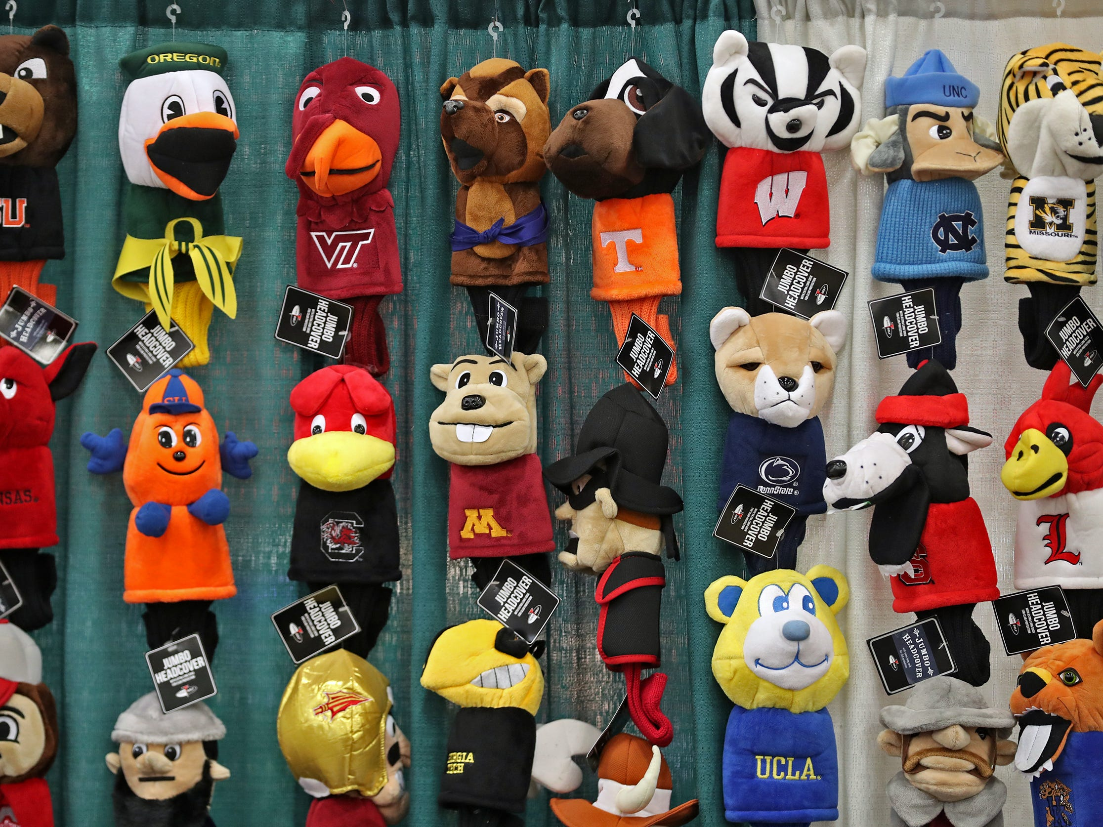 Club head covers with College logos are seen for sale at the CollegeGolfStore.com booth during the Indy Golf Expo at the Indiana State Fairgrounds, Sunday, Jan. 20, 2019.
