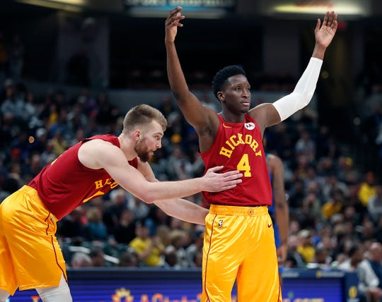 Indiana Pacers guard Victor Oladipo (4) and Domantas Sabonis (11) begin to celebrate their win late in the fourth quarter of their game at Bankers Life Fieldhouse Saturday, Jan. 19, 2019. The Indiana Pacers defeated the Dallas Mavericks 111-99.
