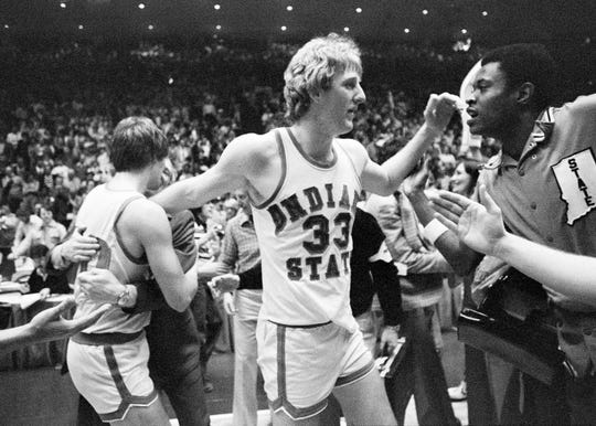Indiana State star Larry Bird makes his way through the crowd of players and fans getting congratulations after his team defeated Arkansas, 73-71, to win the NCAA Midwest Regional tourney crown in Cincinnati, March 17, 1979.