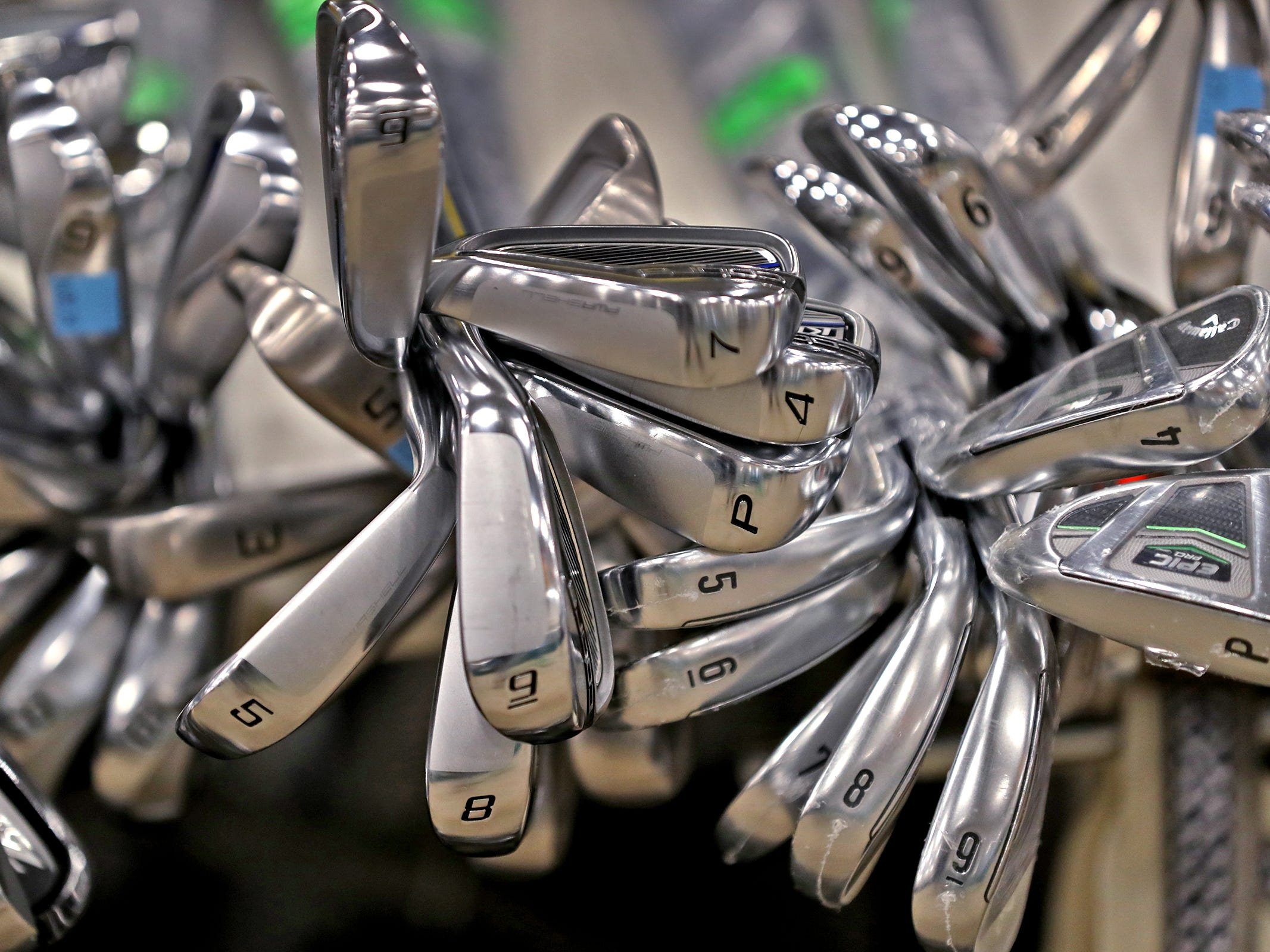 Golf clubs are seen at the Golfmart Kentucky booth during the Indy Golf Expo at the Indiana State Fairgrounds, Sunday, Jan. 20, 2019.