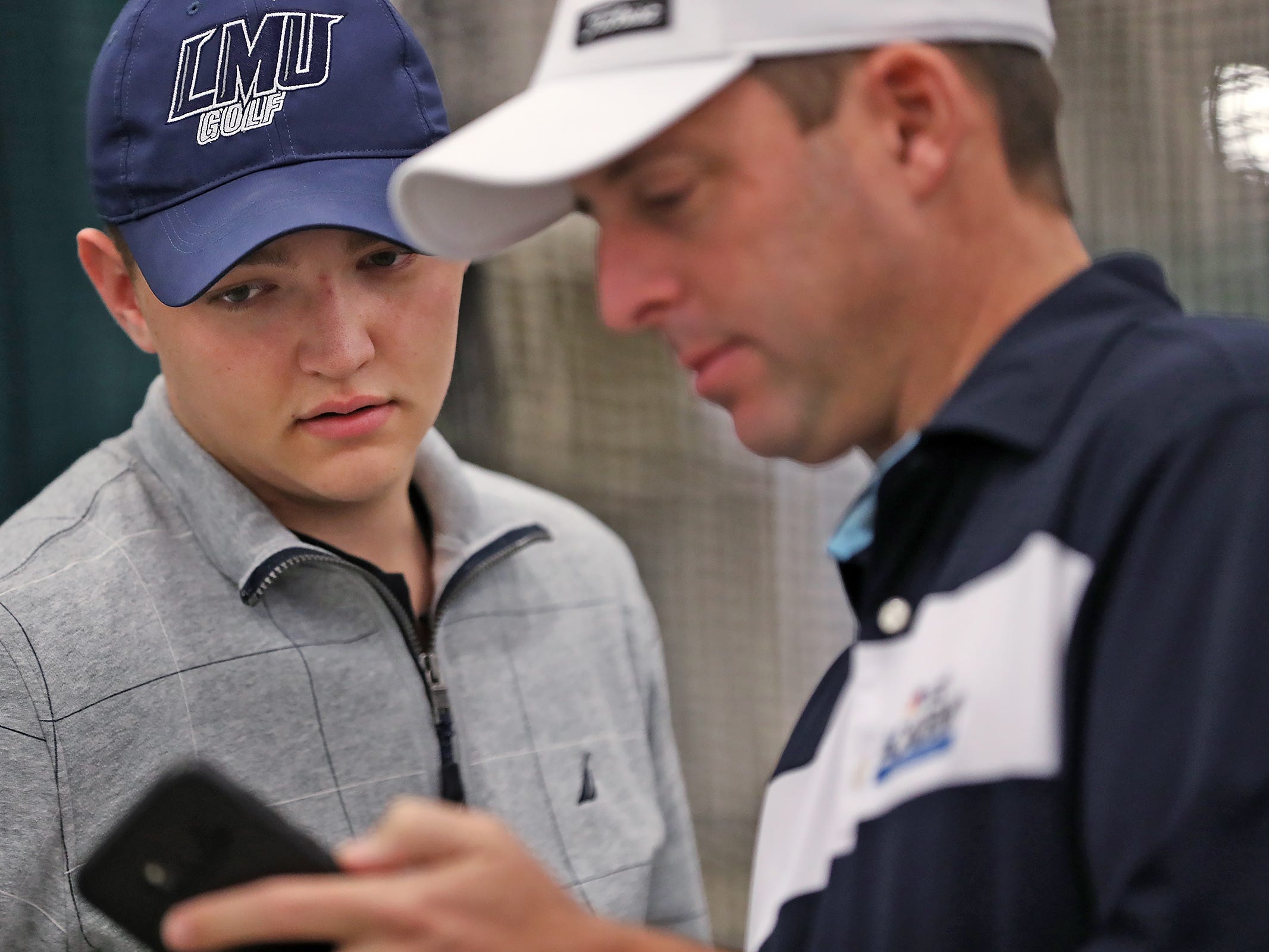 Brett Widner, left, gets tips about his golf swing from Colby Huffman at the Golf Channel with Colby Huffman booth during the Indy Golf Expo at the Indiana State Fairgrounds, Sunday, Jan. 20, 2019.