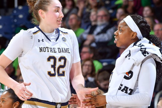 Jan 20, 2019; South Bend, IN, USA; Notre Dame Fighting Irish guard Arike Ogunbowale (24) greets forward Jessica Shepard (32) as she leaves the court in the second half against the Boston College Eagles at the Purcell Pavilion.