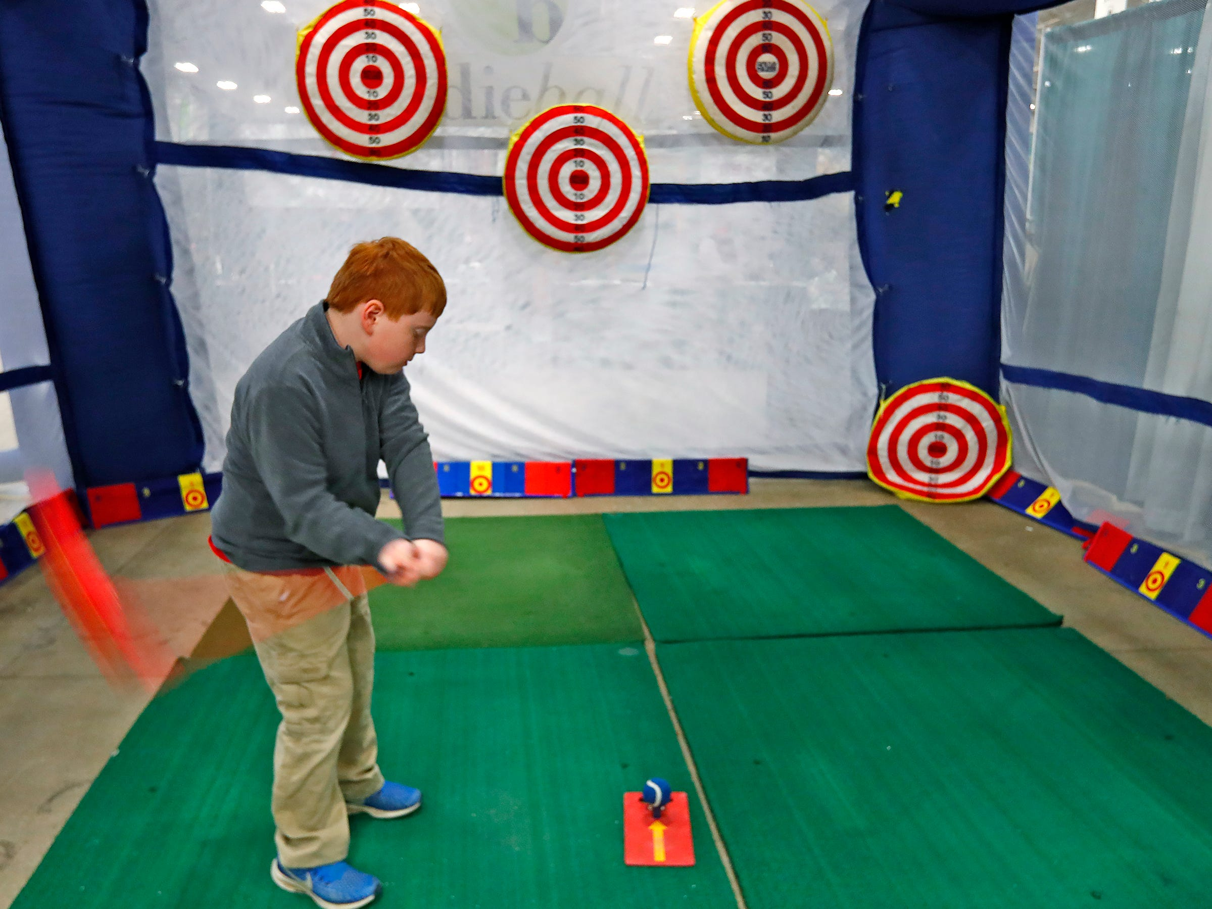 Edison Armbrester tests his golf swing during the Indy Golf Expo at the Indiana State Fairgrounds, Sunday, Jan. 20, 2019.