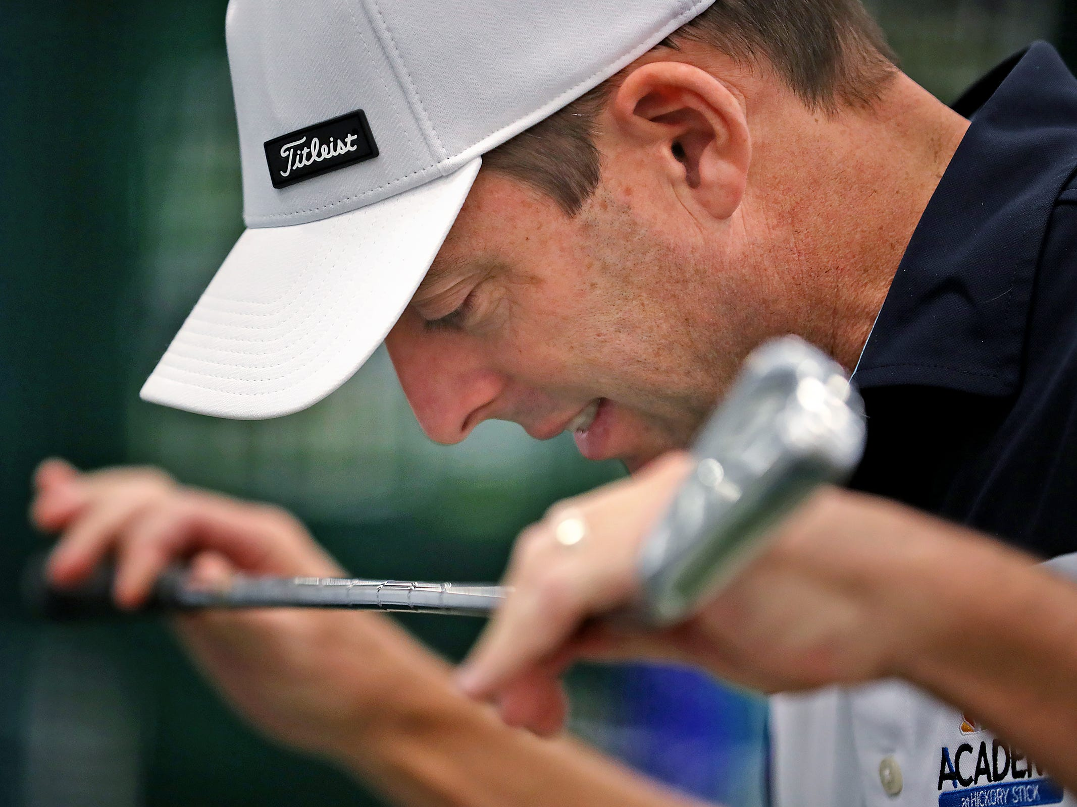Colby Huffman shows the positioning of the head during a golf swing, as he gives advice to a golfer during the Indy Golf Expo at the Indiana State Fairgrounds, Sunday, Jan. 20, 2019.
