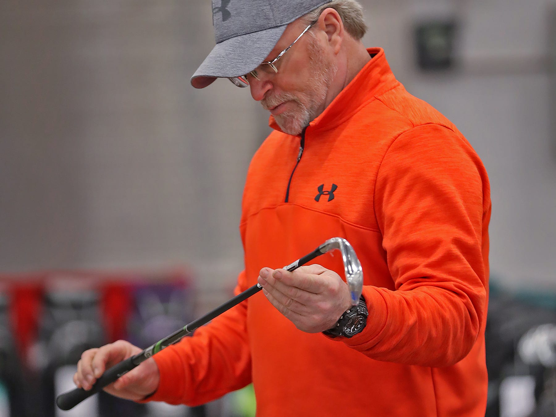 Bruce Stevens looks at clubs at the L&M Golf Shop booth during the Indy Golf Expo at the Indiana State Fairgrounds, Sunday, Jan. 20, 2019.