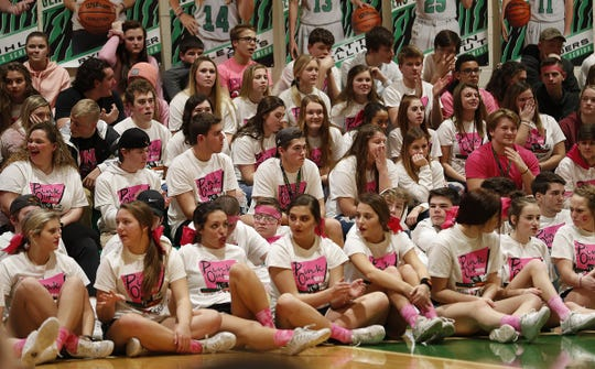 The 11th annual Pink Out game at Triton Central High School on Friday, Jan. 18, 2019. The Pink Out game honors breast cancer survivors and supports the I.W.I.N. (Indiana Women in Need). Foundation.