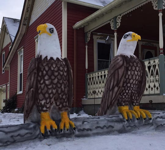 A pair of bald eagles created by Rick Horton, a Greenfield man who has been making sculptures out of snow for more than 20 years.