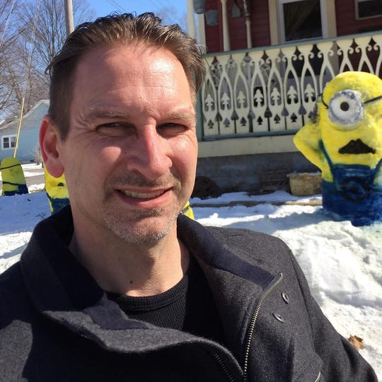 Horton takes a selfie with the snow Minions he made in 2015.