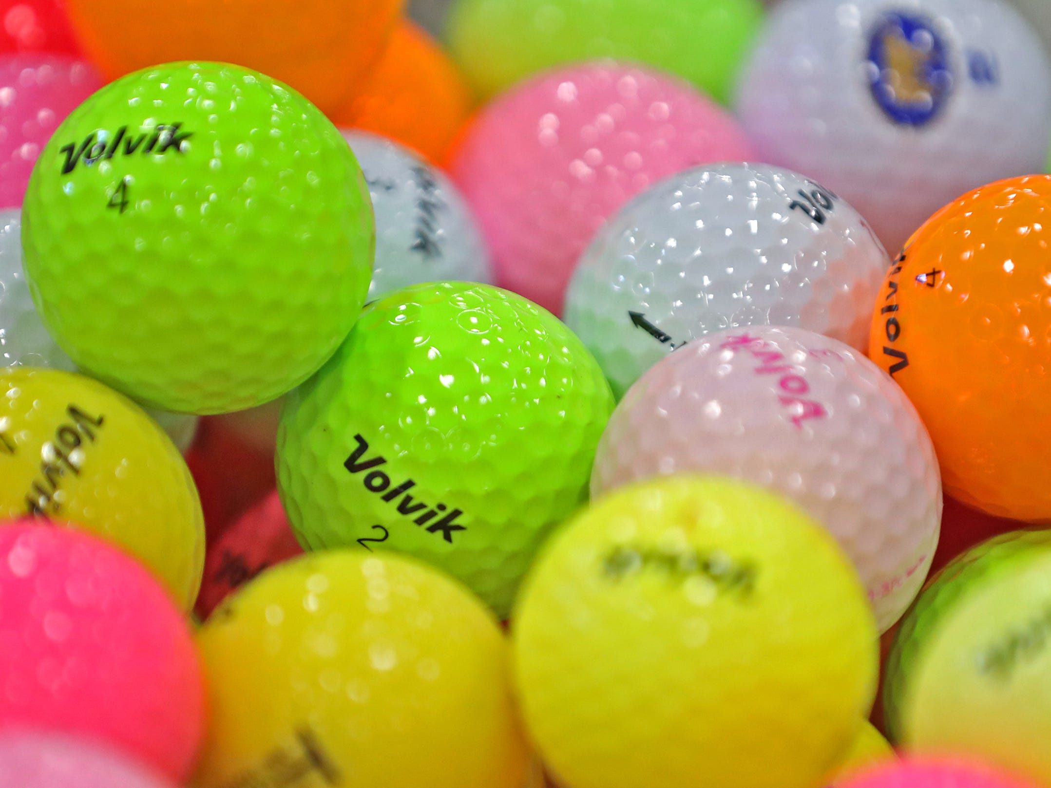 Golf balls of all colors are for sale at the Sharp Golf Ball Co. booth, during the Indy Golf Expo at the Indiana State Fairgrounds, Sunday, Jan. 20, 2019.