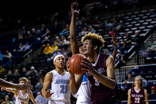Oskaloosa's Xavier Foster (34) drives to the hoop during a boys' basketball game in the Wells Fargo Advisors Shootout on Saturday, Jan. 19, 2019, at the U.S. Cellular Center in Cedar Rapids, Iowa.