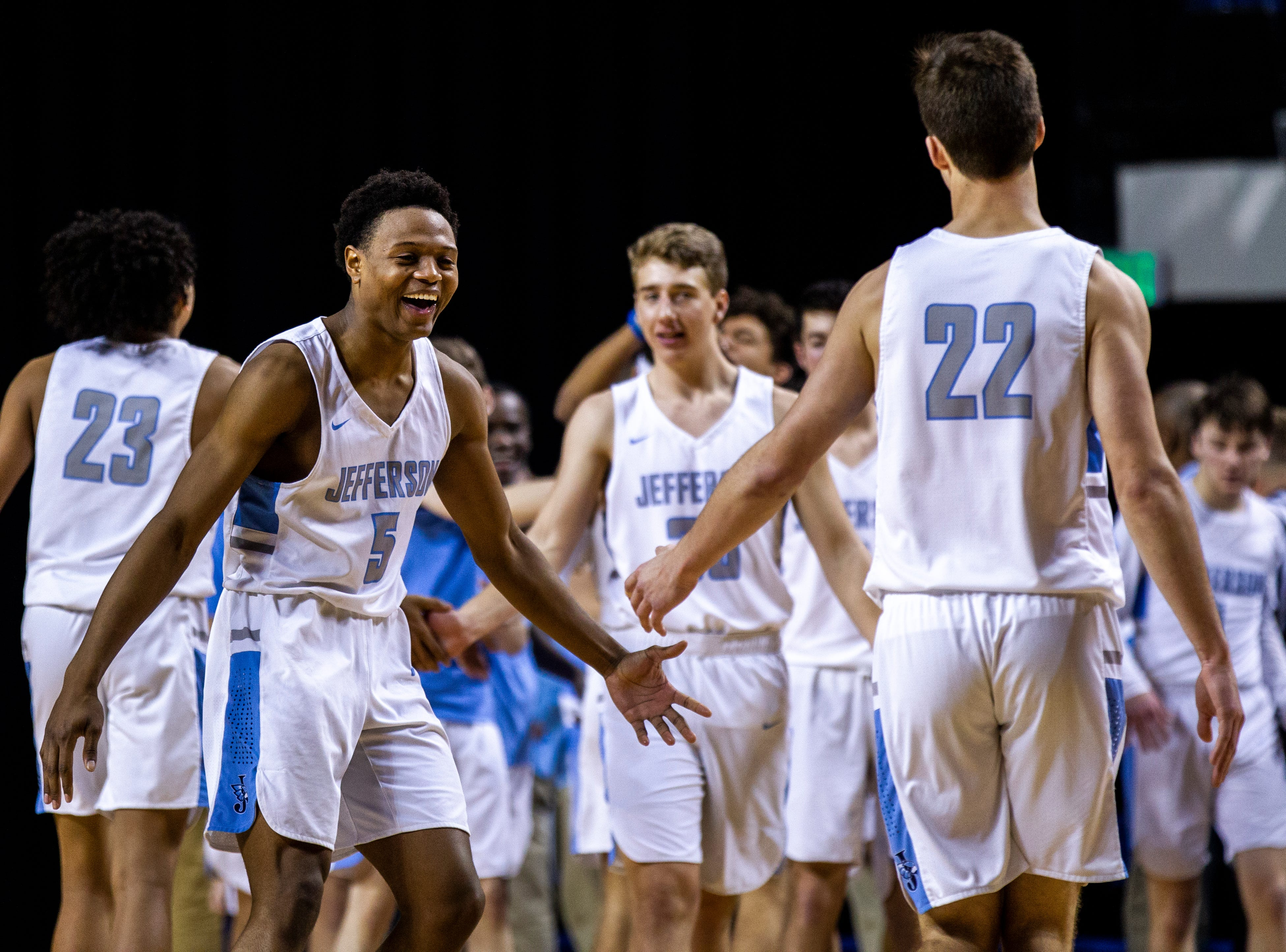 Cedar Rapids Jefferson's 	Raejzuan Shockley (5) celebrates with 	Jackson Snyder (22) after a boys' basketball game in the Wells Fargo Advisors Shootout on Saturday, Jan. 19, 2019, at the U.S. Cellular Center in Cedar Rapids, Iowa.