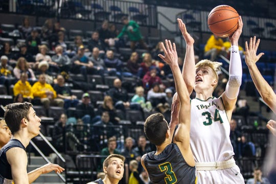 Iowa City West's Even Brauns (34) will play his college basketball at Belmont.