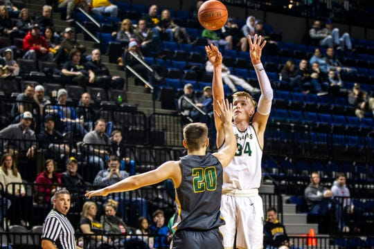 Iowa City West's Even Brauns (34) shoots a 3-point basket during a boys' basketball game in the Wells Fargo Advisors Shootout on Saturday, Jan. 19, 2019, at the U.S. Cellular Center in Cedar Rapids, Iowa.