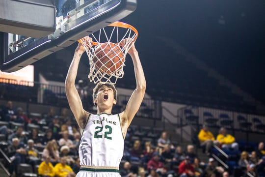 Iowa City West's Patrick McCaffery (22) dunks during a boys' basketball game in the Wells Fargo Advisors Shootout on Saturday, Jan. 19, 2019, at the U.S. Cellular Center in Cedar Rapids, Iowa.