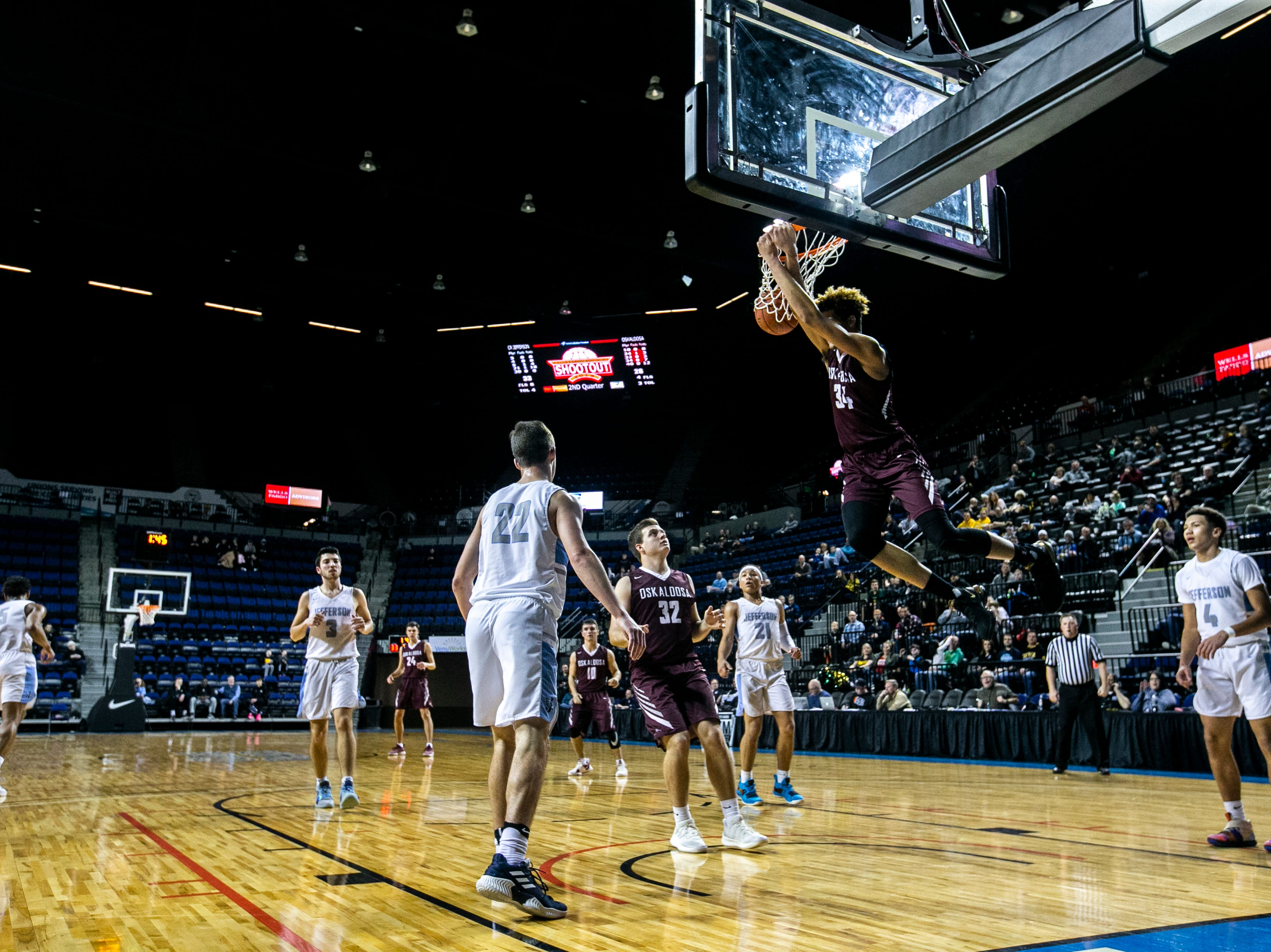 Oskaloosa's Xavier Foster (34) dunks during a boys' basketball game in the Wells Fargo Advisors Shootout on Saturday, Jan. 19, 2019, at the U.S. Cellular Center in Cedar Rapids, Iowa.