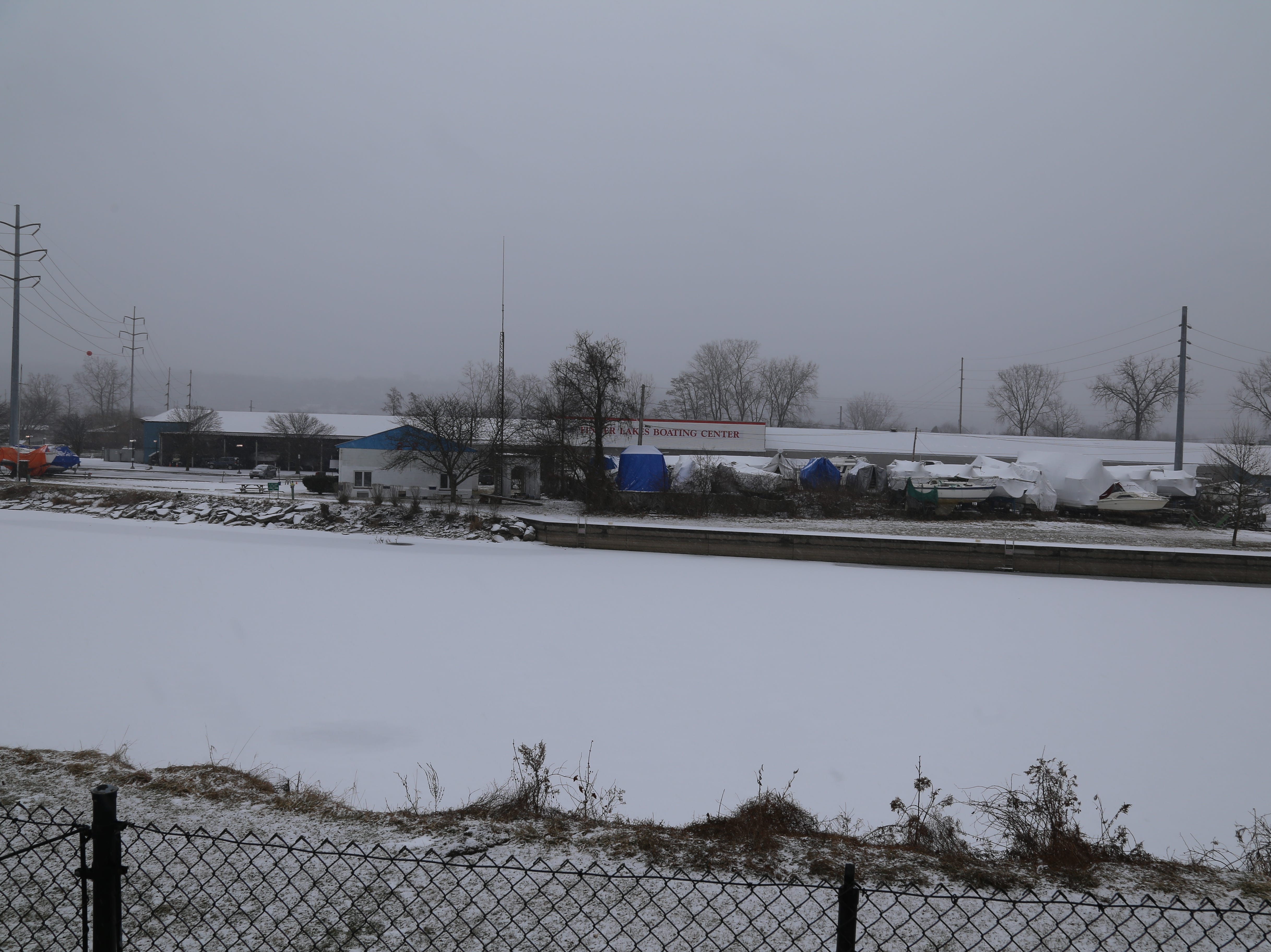 Early snowfall in Ithaca Saturday — the day a winter storm hit the Southern Tier. The snow covered the Cayuga Inlet.