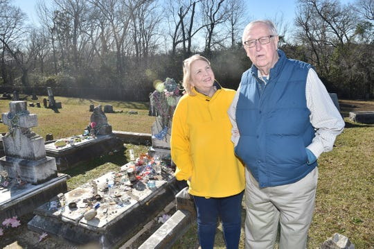 Ann McKee and Ward Calhoun talk about the life of Kelly Mitchell, Queen of the Gypsies, beside her grave at Rose Hill Cemetery in Meridian.