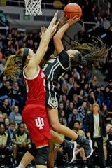 Purdue freshman Kayana Traylor drives to the basket against IU's Brenna Wise as the Boilermakers beat the Hoosiers in a nail biter Sunday at Mackey Arena.