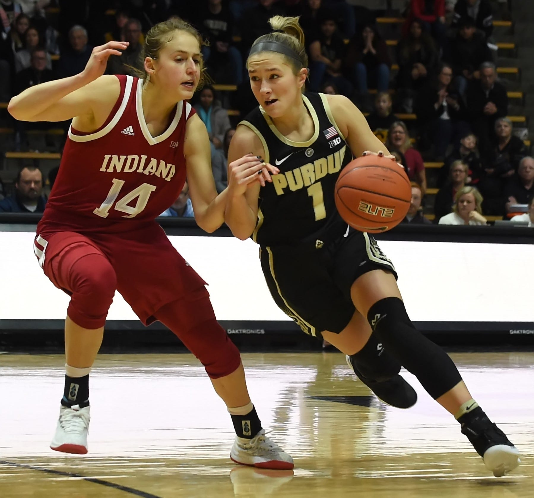 Sophomore guard Karissa McLaughlin on a fast break at the top of the key against Hoosier junior Ali Patberg Sunday at Mackey Arena.