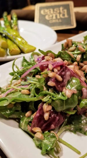 Farro Salad with arugula, roasted beets, red onion, and white balsamic vinaigrette at East End Grill.